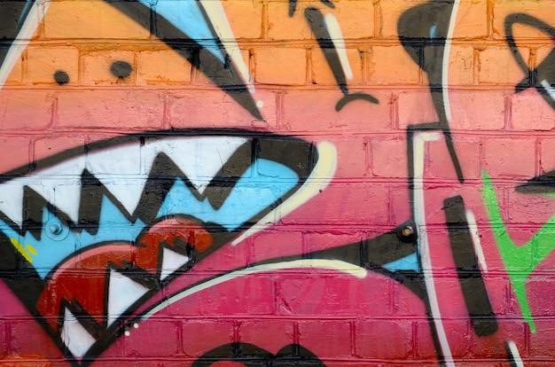 Fragment Coloré Abstrait De Peintures Graffiti Sur Le Vieux Mur De Briques Photo Premium