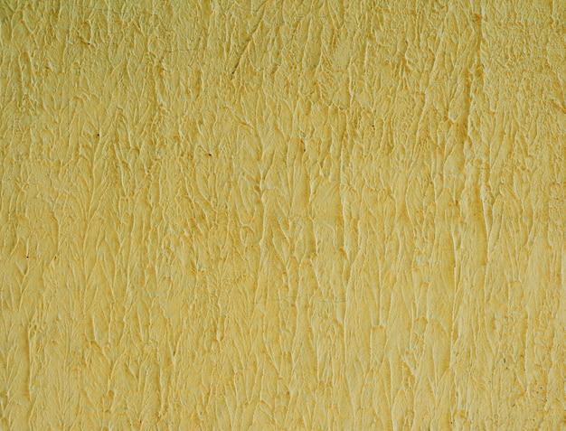 Fragment de mur de ciment jaune, structure ondulée Photo Premium