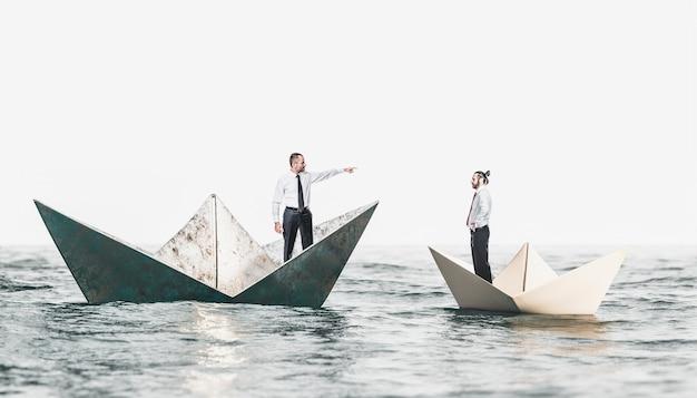 Gens D'affaires Sur Des Bateaux En Métal Et En Papier Photo Premium