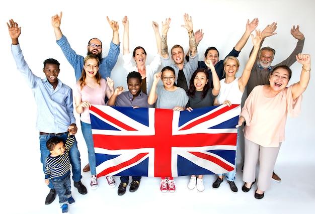 Gens, groupe, tenue, drapeau pays Photo Premium