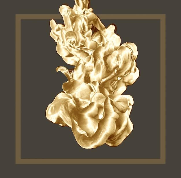 Goutte d'encre abstraite d'or sur fond clair avec cadre. Photo Premium