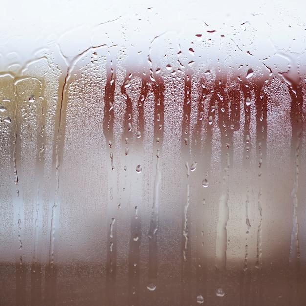 Gouttes de pluie sur la fenêtre Photo gratuit
