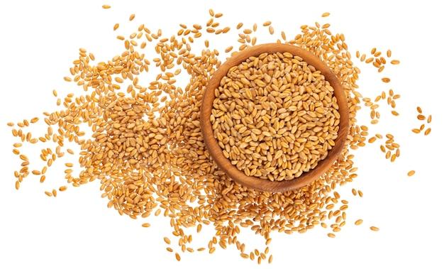 Grains de blé isolés sur blanc, vue de dessus Photo Premium