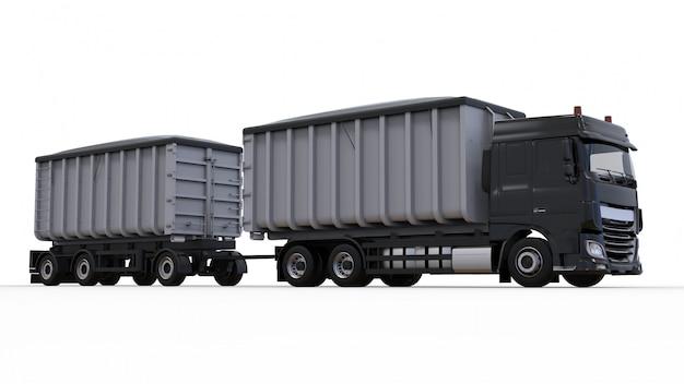 Grand camion noir avec remorque séparée, pour le transport de matériaux et de produits agricoles et de matériaux de construction en vrac Photo Premium