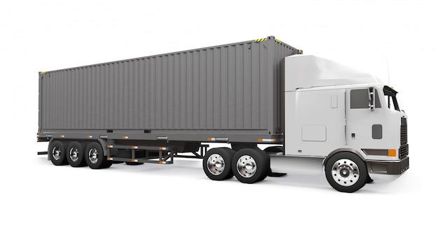 Un Grand Camion Rétro Blanc Avec Une Partie Couchage Et Une Extension Aérodynamique Porte Une Remorque Avec Un Conteneur Maritime Photo Premium