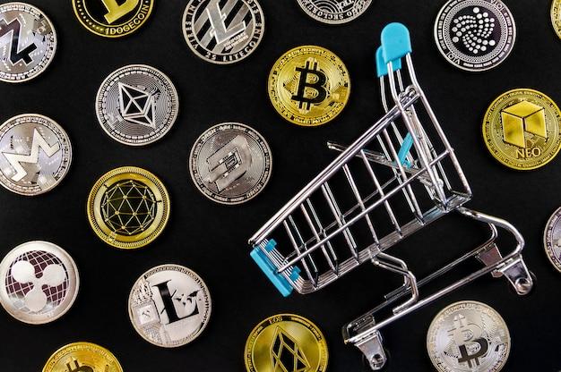 Un grand nombre de pièces de crypto-monnaie se trouvent sur une surface sombre Photo Premium