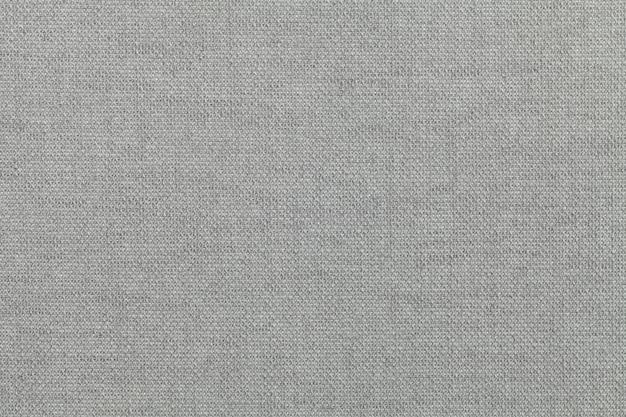 Gris clair, fond en matière textile. tissu à texture naturelle. toile de fond. Photo Premium