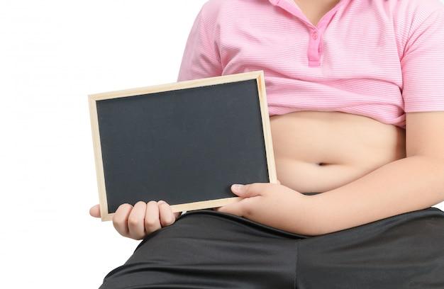 Gros obèse tenant un tableau vide isolé Photo Premium