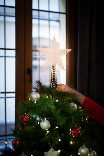 Gros plan, brillant, étoile noël, sommet, arbre Photo gratuit