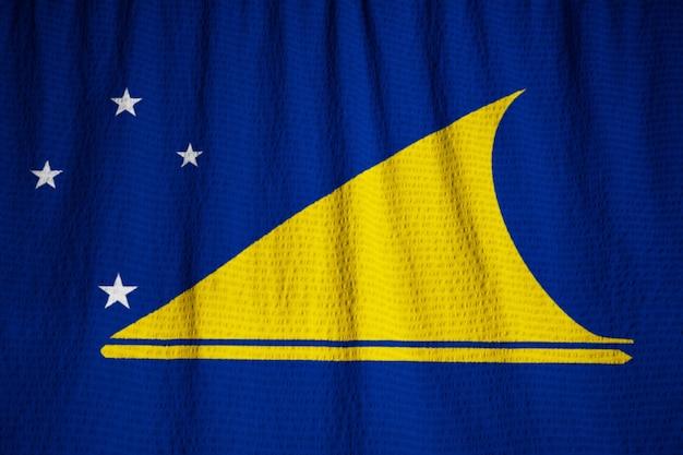 Gros Plan Du Drapeau De Tokelau ébouriffé, Drapeau De Tokelau Soufflant Dans Le Vent Photo Premium