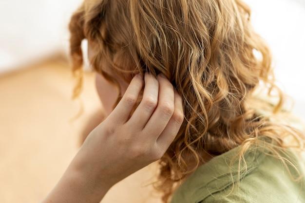 Gros plan, femme, cheveux roux Photo gratuit