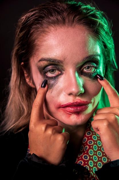 Gros plan, femme, maquillage, portrait, clown Photo gratuit