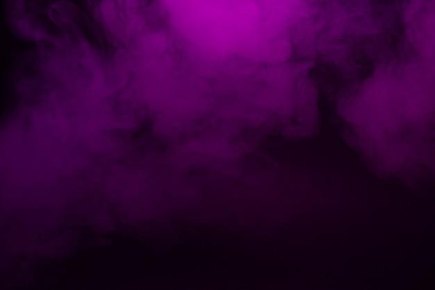Gros plan de fumée colorée sur fond noir Photo Premium