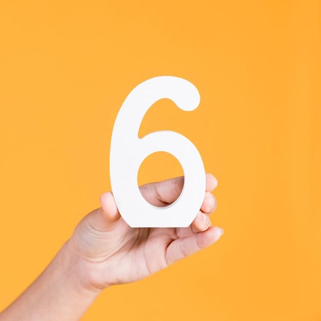 Gros Plan, Main, Tenue, Numéro 6 Photo gratuit