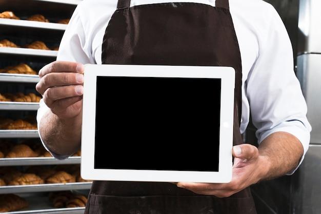 Gros plan, mâle, boulanger, main, noir, écran, tablette numérique Photo gratuit