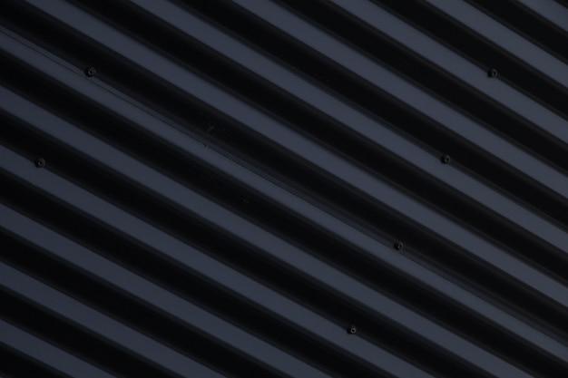 Gros plan, métal, noir brillant, surface ondulée Photo Premium