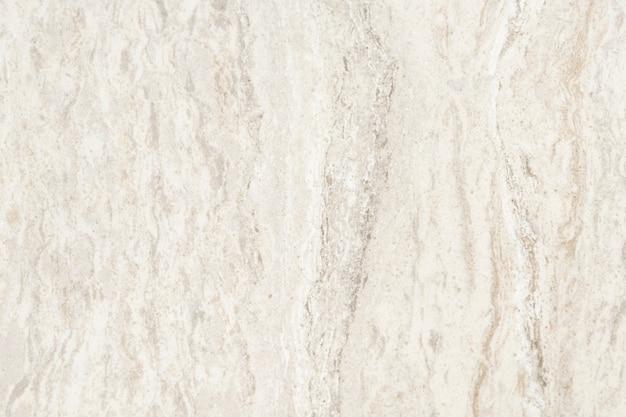 Gros plan d'un mur texturé en marbre blanc Photo gratuit
