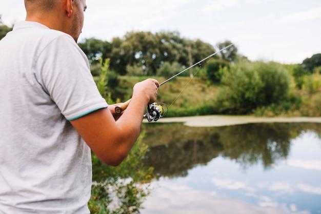 Gros plan, pêcheur, pêche, lac Photo gratuit