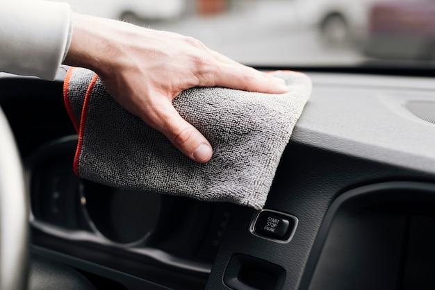 Gros plan, personne, nettoyage, intérieur voiture Photo gratuit
