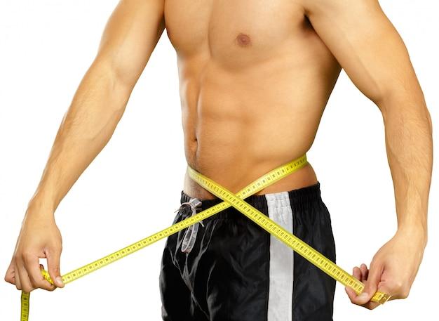 Gros plan photo de sportif mesurant la taille avec du ruban adhésif isolé sur blanc Photo Premium