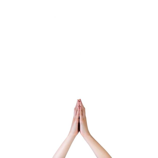 Gros plan, de, a, prière, mains, sur, arrière-plan blanc Photo gratuit