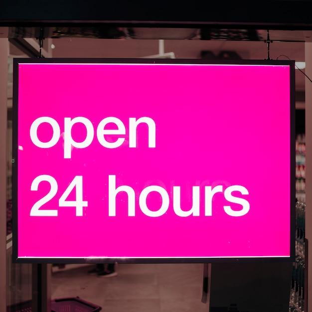 Gros plan rose signe ouvert 24 heures Photo gratuit