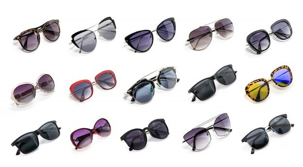 Groupe de belles lunettes de soleil isolées. mode costume. Photo Premium