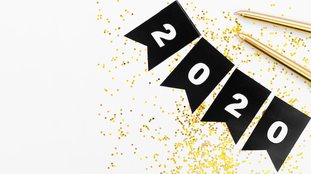 Guirlande Noire Avec Numéro 2020 Et Paillettes Dorées Photo gratuit