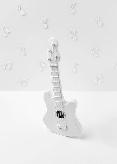 Guitare Blanche à Angle élevé Avec Des Notes De Musique Photo Premium