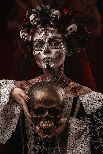 Halloween girl dans un costume de mort Photo Premium