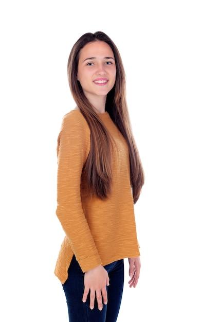 Heureuse adolescente de seize ans regardant la caméra Photo Premium