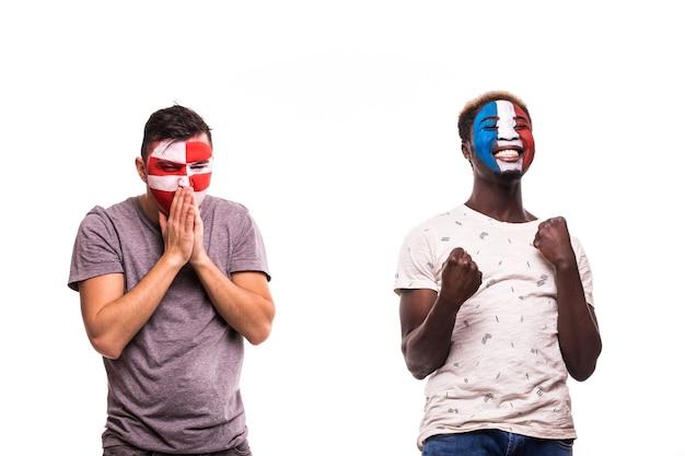 Heureux Fan De Football De France Célébrer La Victoire Sur Le Fan De Football Contrarié De La Croatie Avec Visage Peint Isolé Sur Fond Blanc Photo gratuit