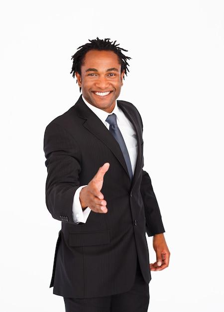 Heureux homme d'affaires saluant avec une poignée de main Photo Premium