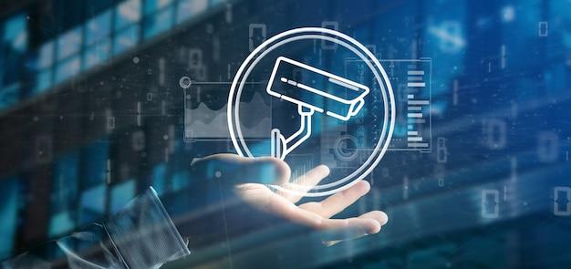 Homme d'affaires détenant l'icône du système de caméra de sécurité et les données statistiques - Photo Premium