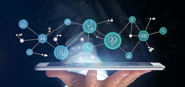 Homme d'affaires détenant l'icône médicale et connexion Photo Premium