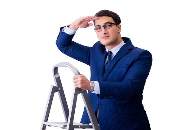 Homme d'affaires en haut de l'échelle isolée Photo Premium