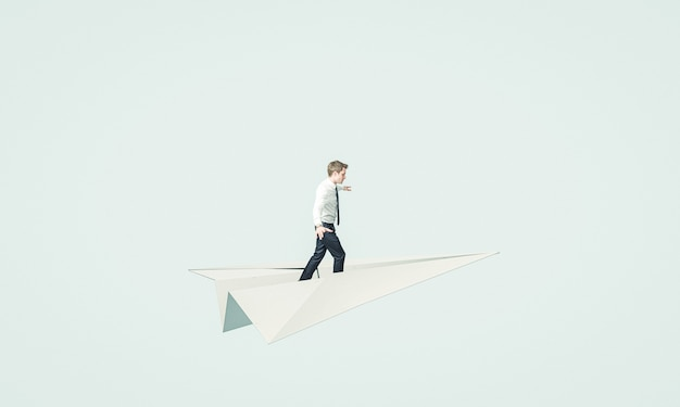 Homme D'affaires Jeune Vole Sur Un Avion En Papier. Photo Premium