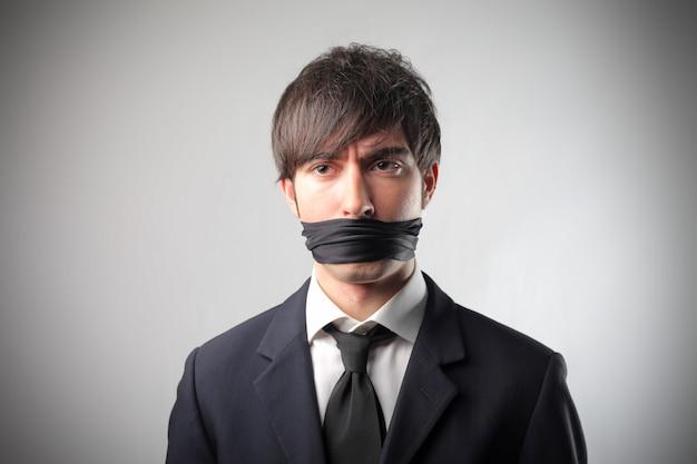 Homme d'affaires lié ne peut pas parler Photo Premium