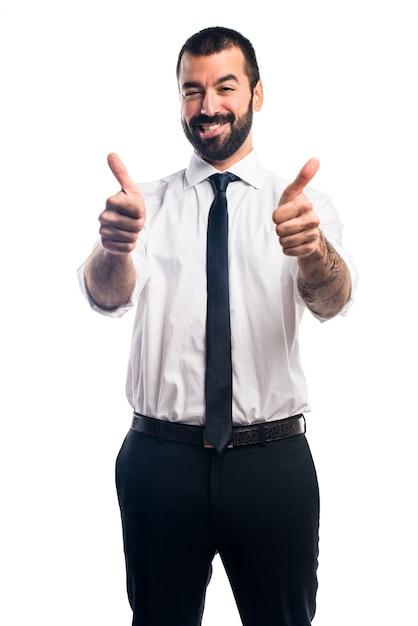 Homme d'affaires avec le pouce vers le haut Photo gratuit