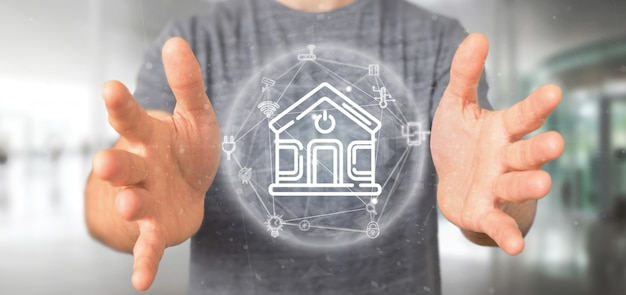 Homme d'affaires tenant une interface maison intelligente avec icône, statistiques et données Photo Premium