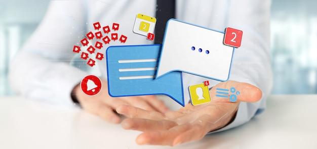 Homme d'affaires tenant un message et des notifications de médias sociaux Photo Premium