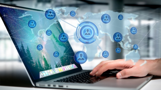 Homme d'affaires tenant un réseau sur une carte du monde connecté Photo Premium