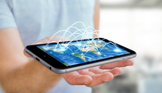 Homme D'affaires Tenant Un Téléphone Portable Avec Une Connexion Internet Photo Premium