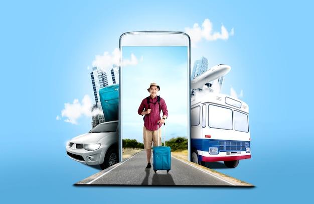 Homme asiatique au chapeau avec valise sac et sac à dos, debout dans la rue Photo Premium