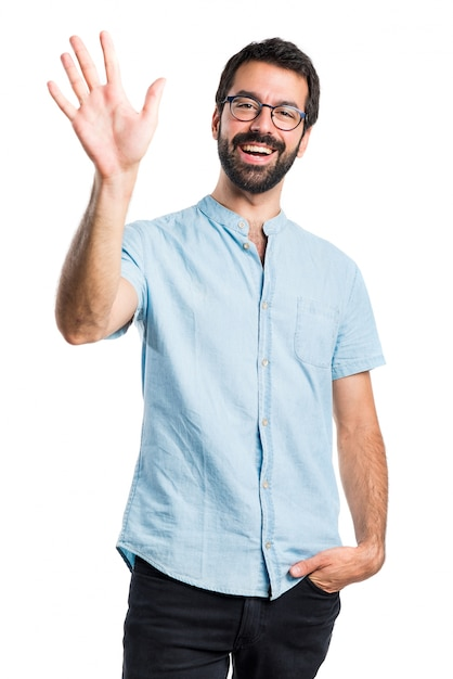 Un homme beau saluant Photo gratuit
