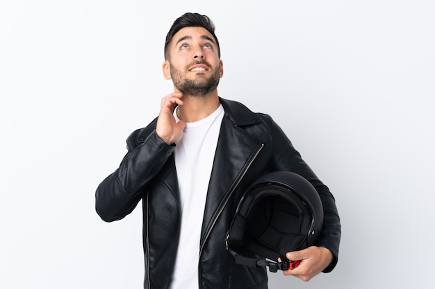 Homme Avec Un Casque De Moto Pense à Une Idée Photo Premium