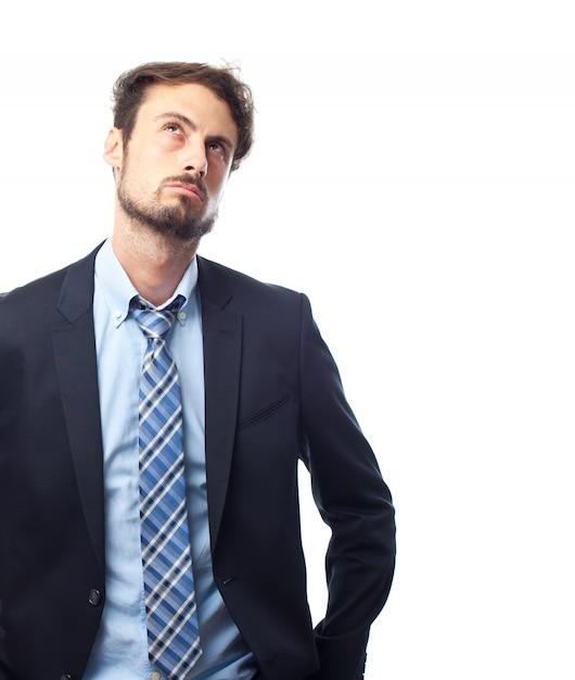 Homme en costume réfléchie Photo gratuit