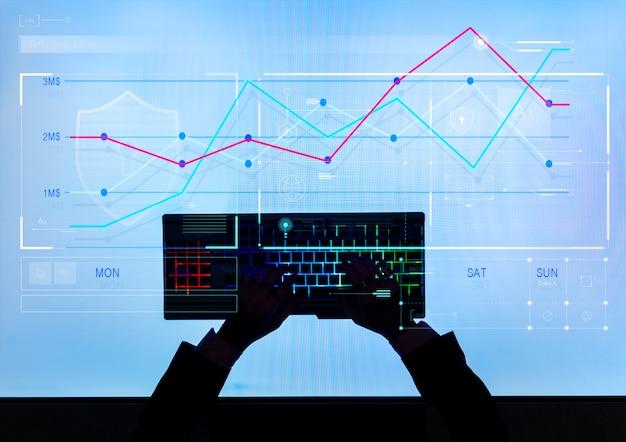 Homme dactylographie générant des données boursières Photo Premium