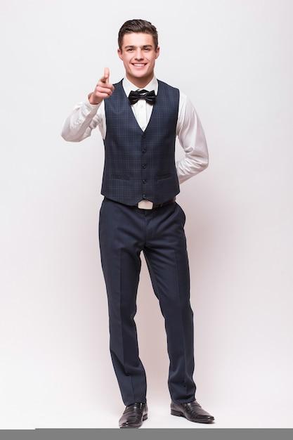 Homme élégant En Costume Isolé Sur Mur Blanc Photo gratuit