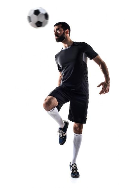L'homme Joue Au Football Photo gratuit